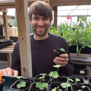 Picture of Sam in the greenhouse